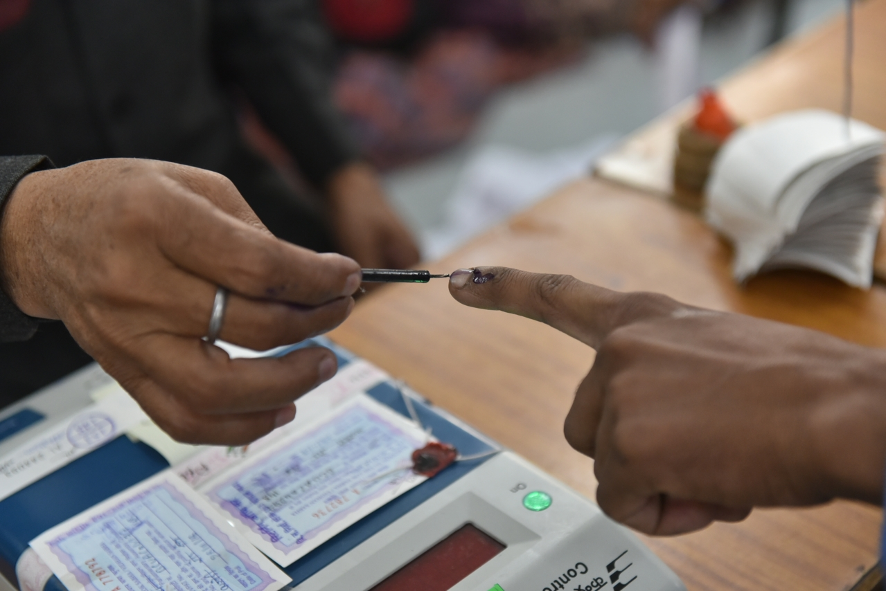 An election officer applies an indelible ink mark on the finger during voting, at a polling station, in Jahangirabad on 28 November 2018 in Bhopal, MP. (Mujeeb Faruqui/Hindustan Times via GettyImages)