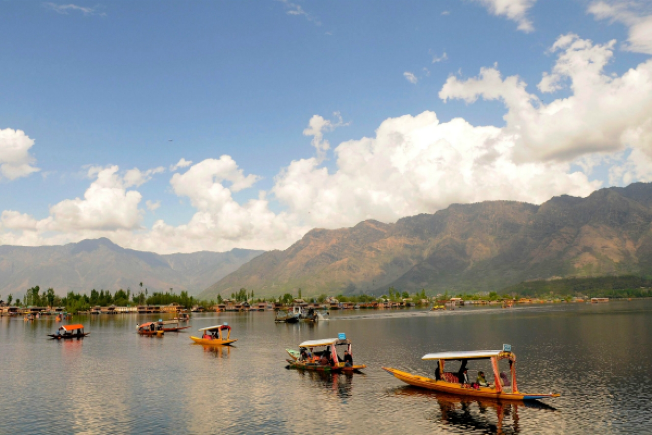 Tourists enjoy shikara ride on the waters of Dal Lake in Srinagar. (Waseem Andrabi/Hindustan Times via Getty Images)