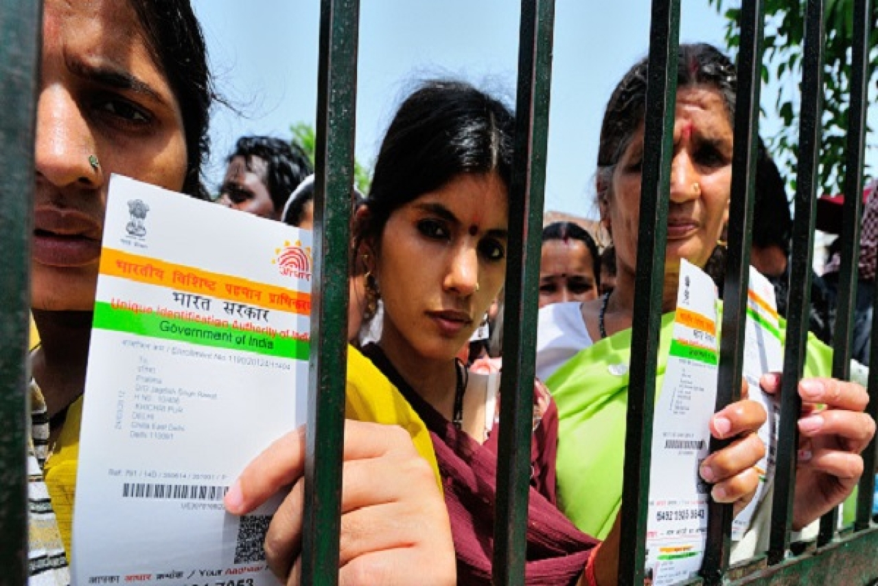 Women with their Aadhaar cards at a government camp in New Delhi. (Priyanka Parashar/Mint via GettyImages)