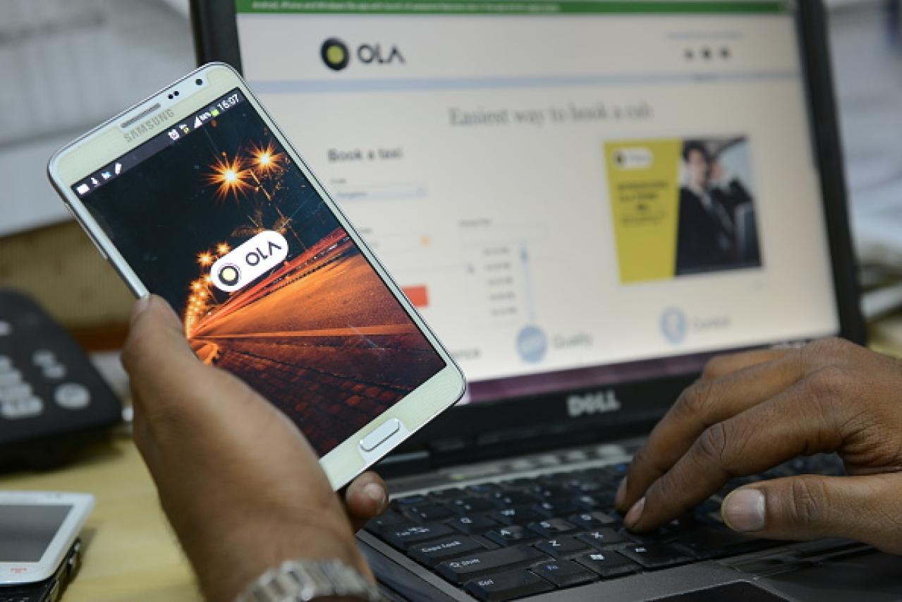 Representative image of the Ola app on a smartphone (Hemant Mishra/Mint via Getty Images)