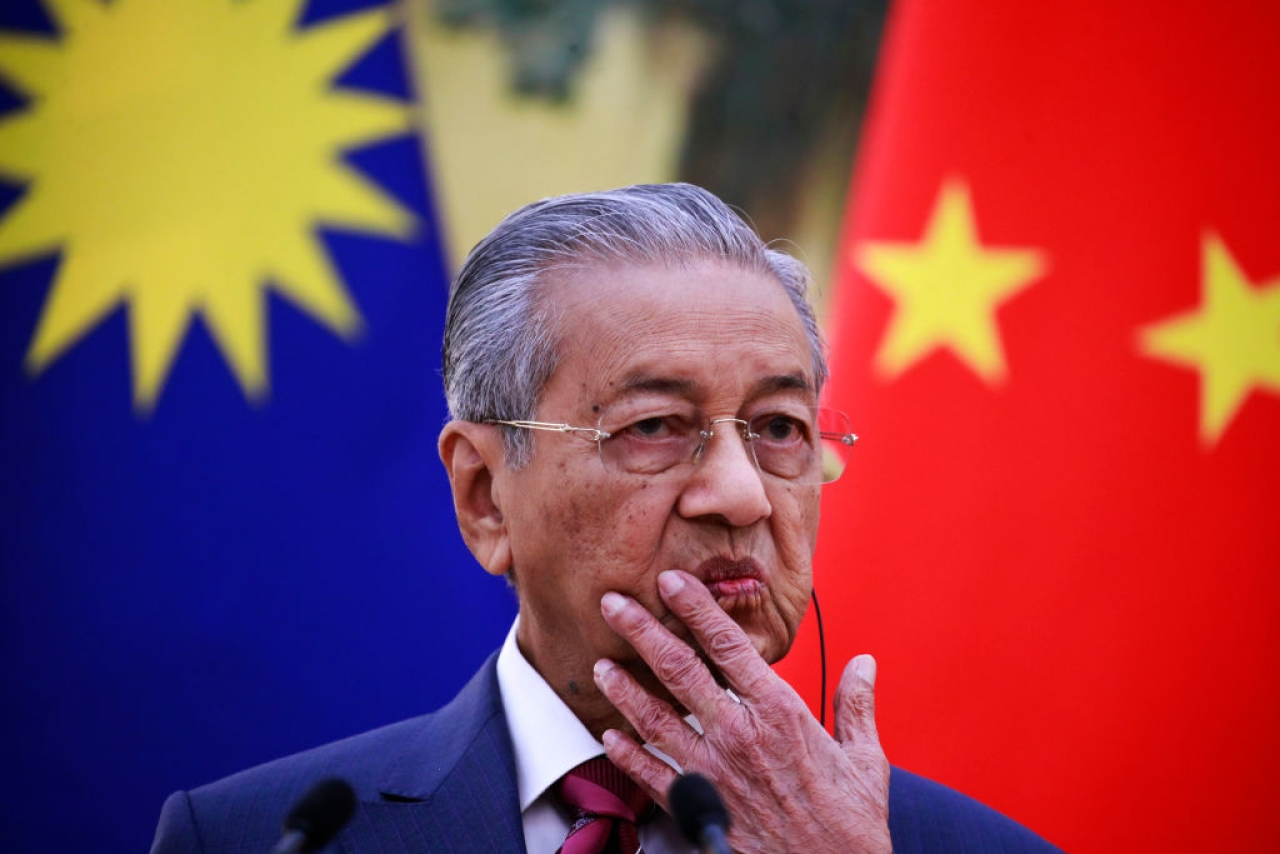 Malaysian Prime Minister Mahathir Mohamad gestures as he speaks during a press conference at the Great Hall of the People in Beijing.  (How Hwee Young - Pool/Getty Images)