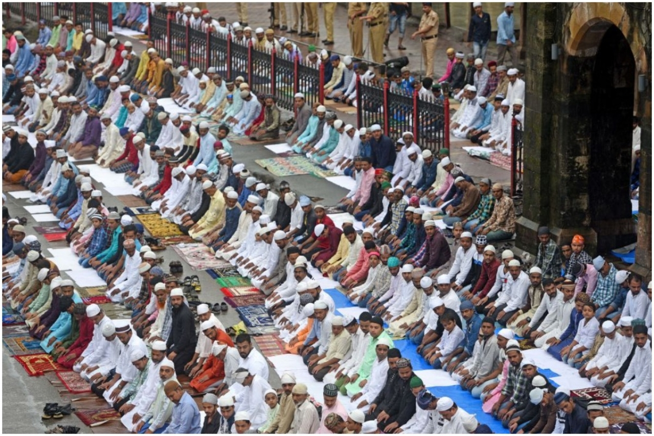 Muslim devotees offer prayers on the occasion of Eid al-Adha outside Bandra Station, (Satyabrata Tripathy/Hindustan Times via Getty Images)