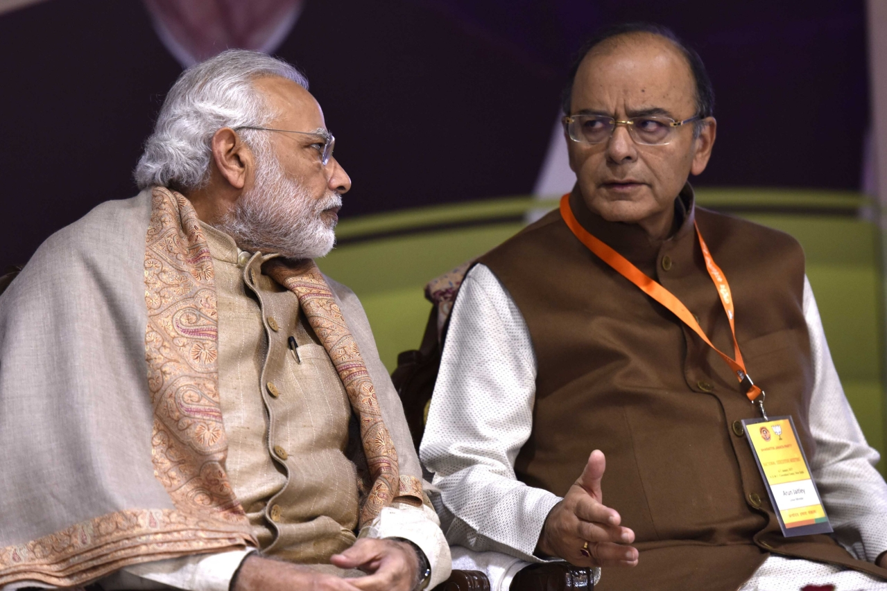 Prime Minister Narendra Modi  with Finance Minister Arun Jaitley. (Virendra Singh Gosain/Hindustan Times via Getty Images)