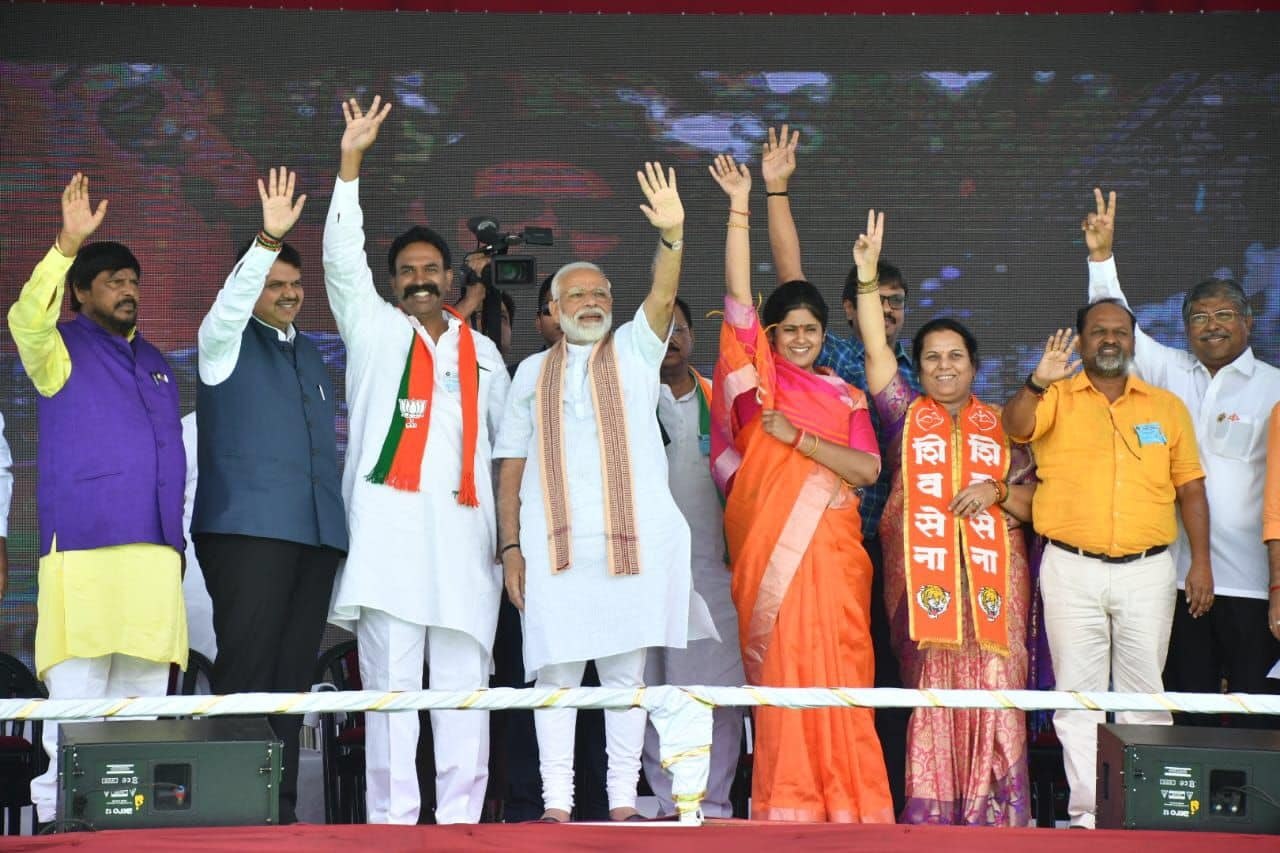 Prime Minister Narendra Modi with Kanchan Kul and other senior party members during an election rally.