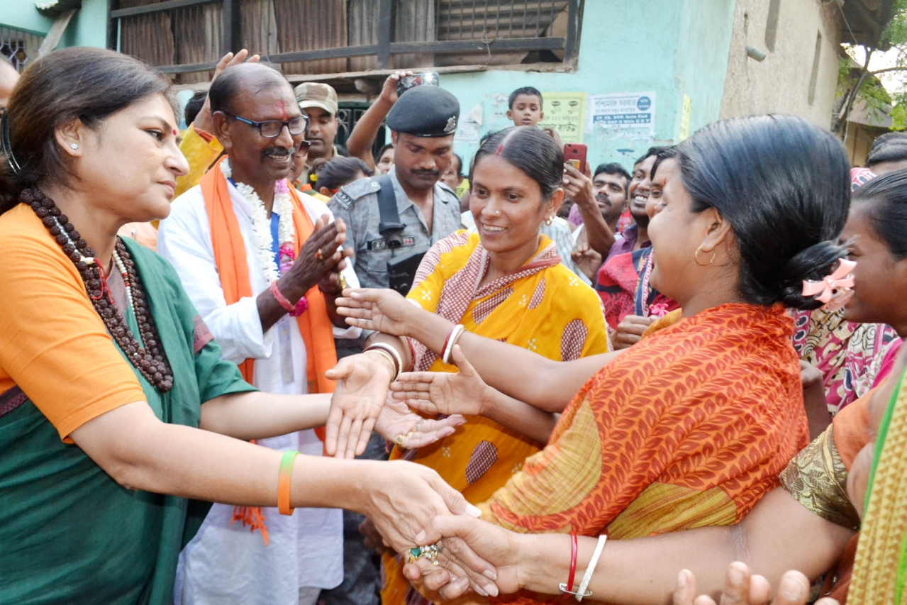 Birbhum BJP candidate Dudh Kumar Mondal (in white) and party leader Rupa Ganguly on the campaign trail in Nalhatier Shitolgram.