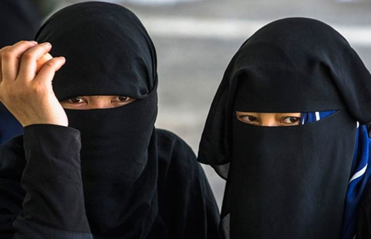 Muslim women in niqab.
