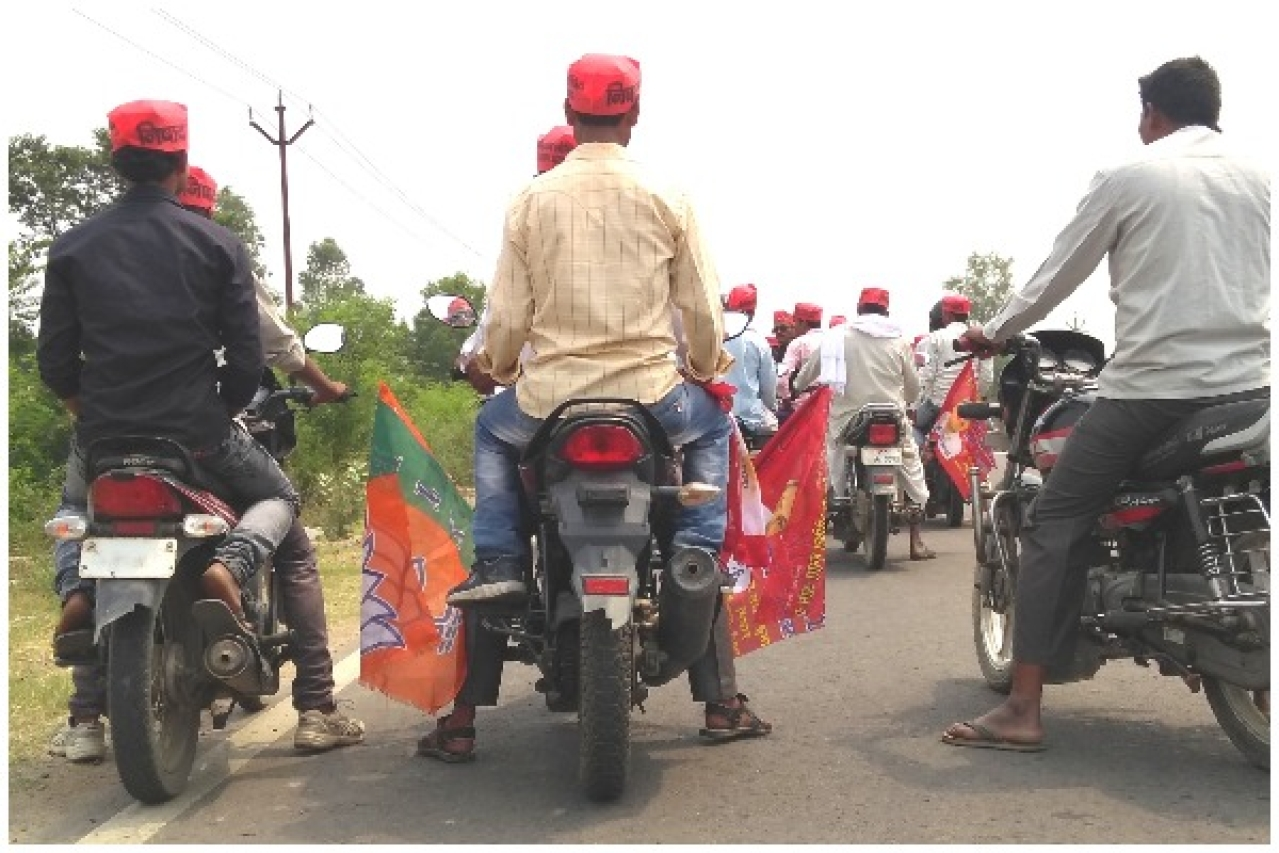 Workers of the NISHAD party ahead of a bike rally with party flags in Gorakhpur's Campirganj Vidhan Sabha. (Prkahar Gupta/Swarajya)