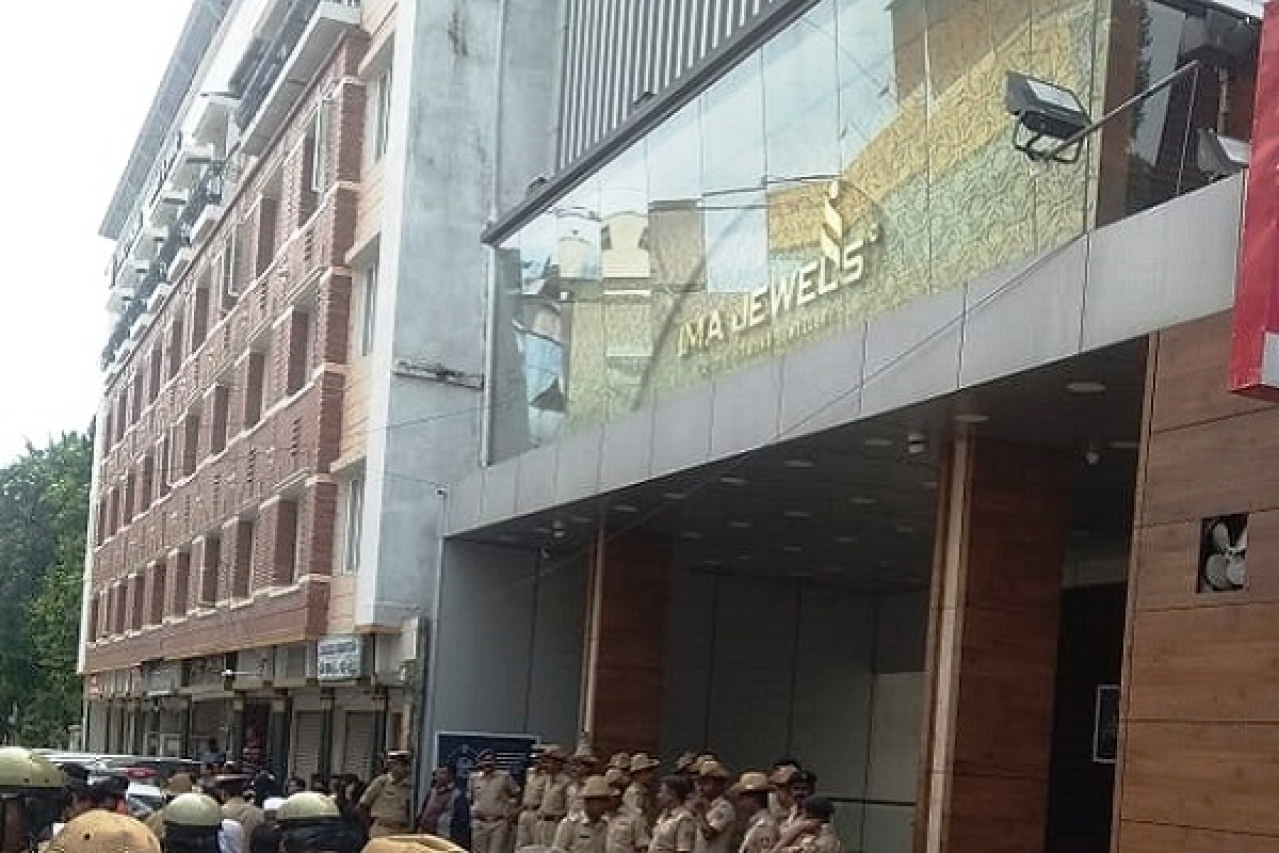 Police presence outside IMA Jewels shop in Shivajinagar