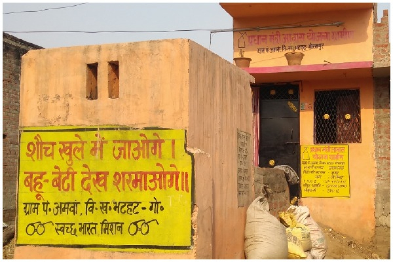 A home and a toilet built under government schemes. (Prakhar Gupta/Swarajya)