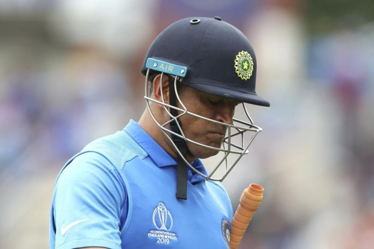 Mahendra Singh Dhoni leaves the field after being given run-out during the semi-final match against New Zealand.