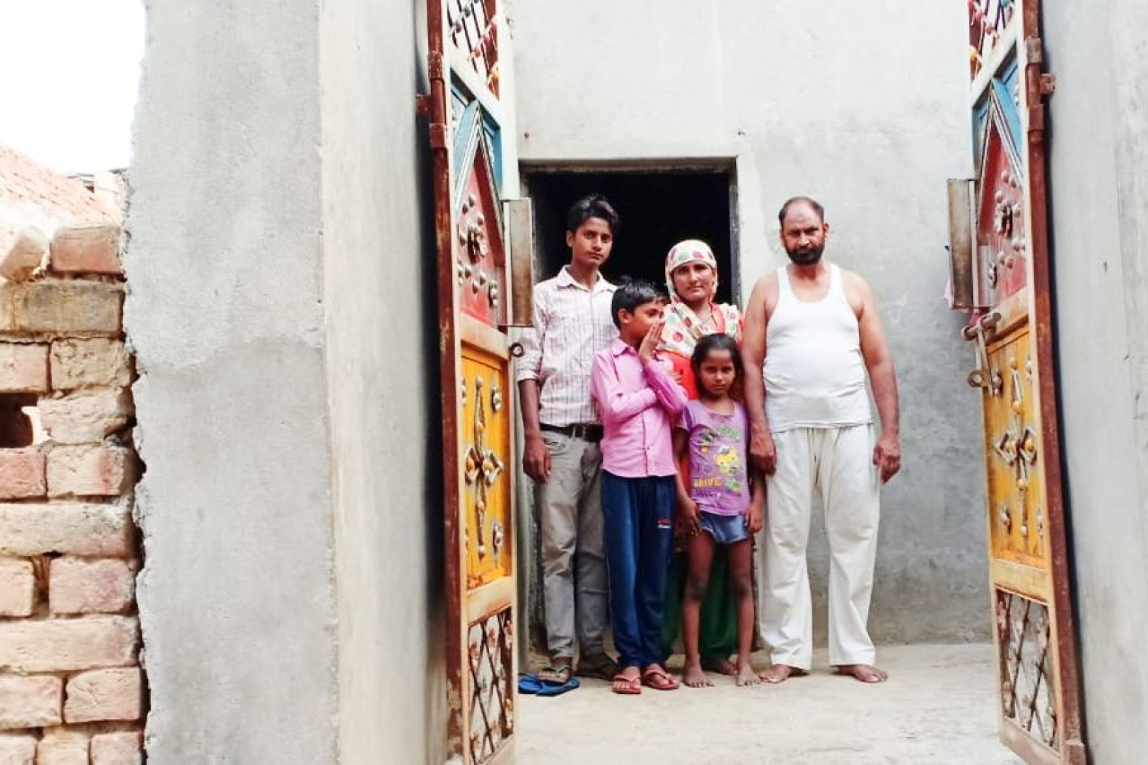 Dilsher Khan with his family in his Mehfooz Nagar house. Photo by special arrangement