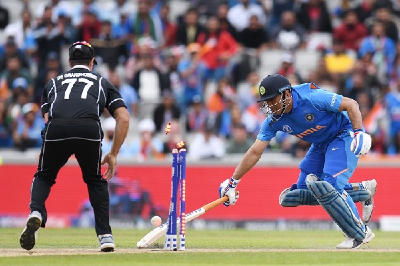 So close, yet so far. MS Dhoni races to reach back during the ICC Cricket World Cup semifinals against New Zealand. New Zealand bet India to play England in the finals, where they lost to the hosts on 'boundaries' after drawing the match twice. (image via @cricketworldcup/Facebook)