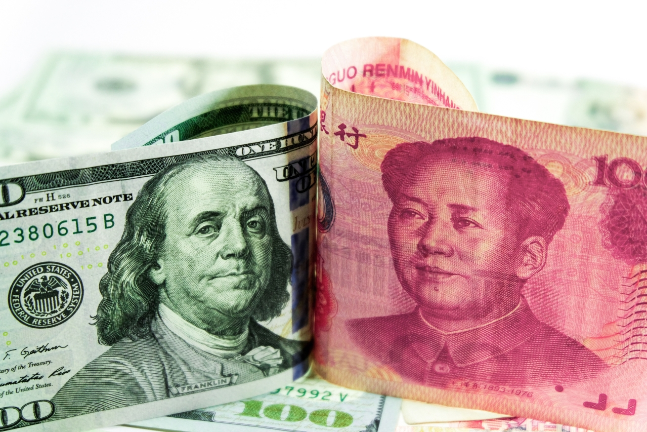 The US Dollar and the Chinese Yuan.