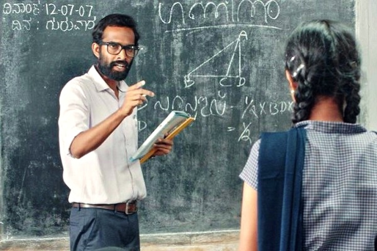 A still from the film, that portrays the central theme - A malayali teacher is appointed to a Kannada medium school and admonishes students who insist on using Kannada