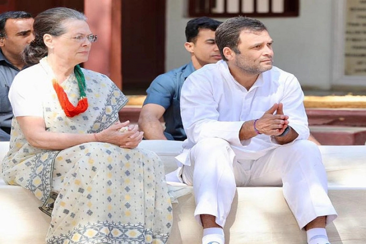 Congress President Sonia Gandhi - left, Rahul Gandhi - right