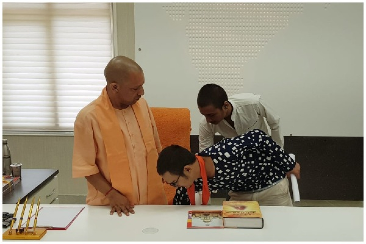 Kamlesh Tiwari's son touches Chief Minister Yogi Adityanath's feet.