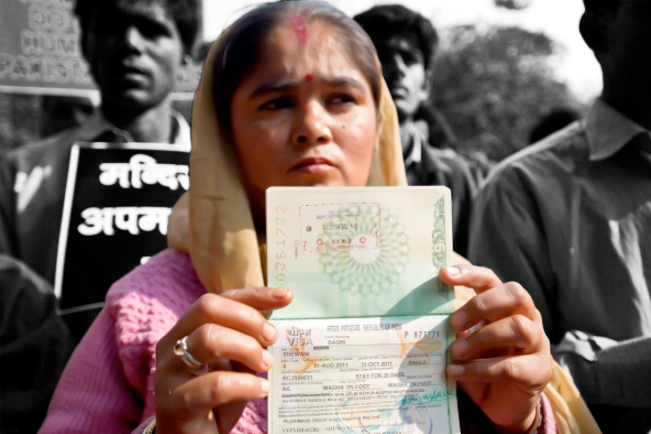 A Hindu refugee from Pakistan shows her now-expired Indian visa page on her passport during a demonstration. (PRAKASH SINGH/AFP/Getty Images)