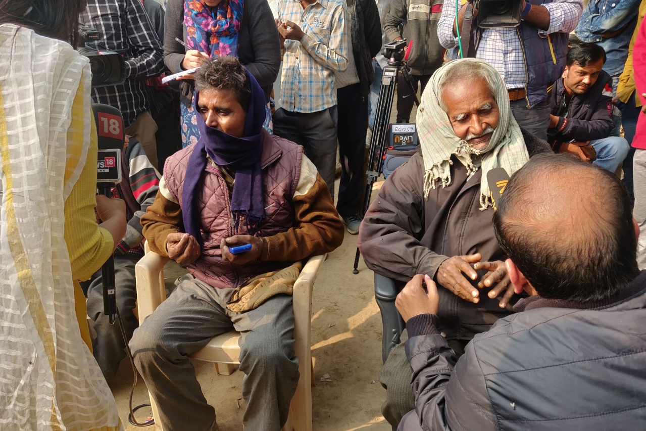 Victim's family talks to the media on morning of 7 December. On left is her uncle Munnu. On his right is her father Ram Kishen/Swati Goel Sharma