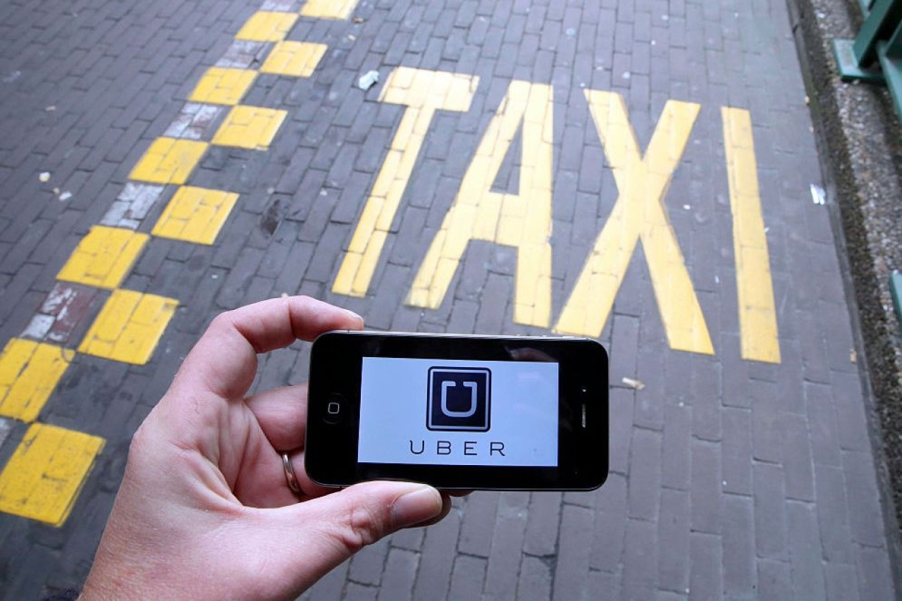The Uber app. (NICOLAS MAETERLINCK/AFP/GettyImages)