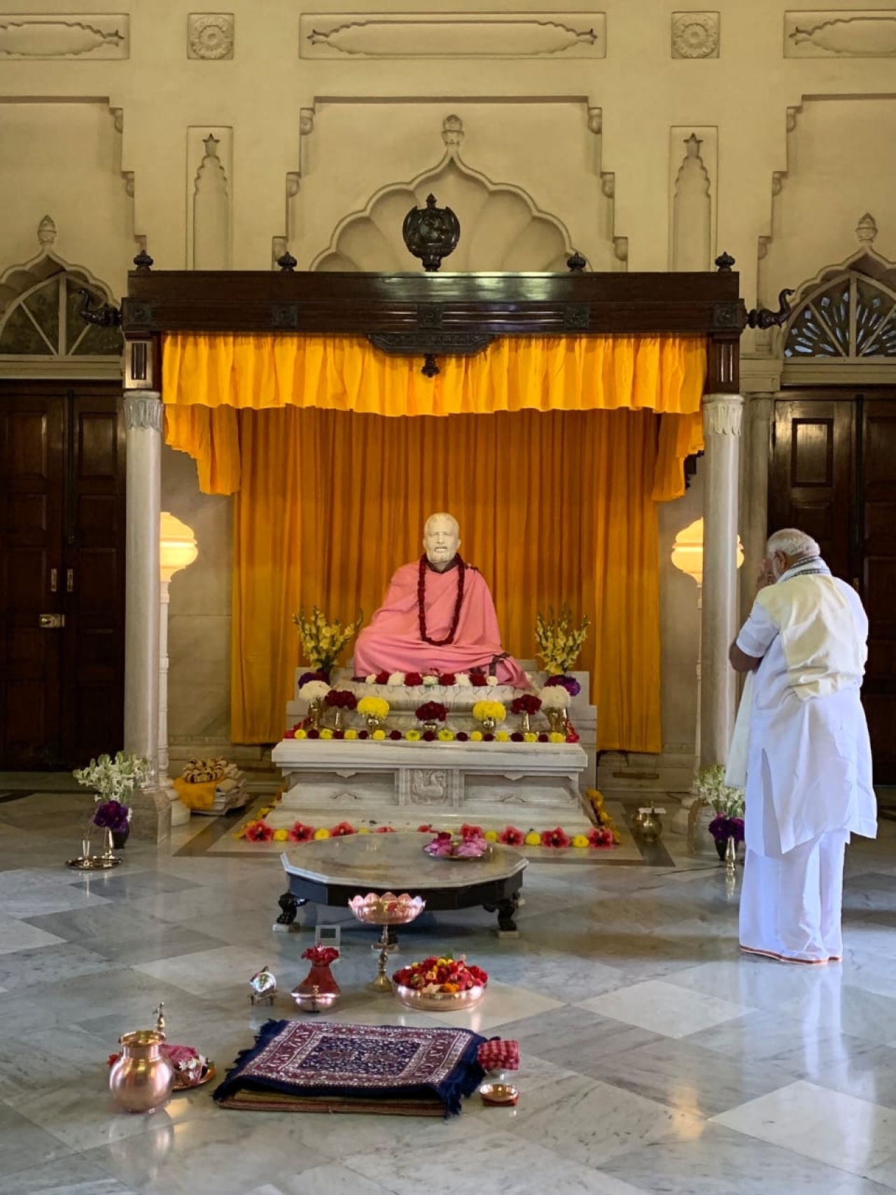A silent prayer at the altar of Sri Ramakrishna.
