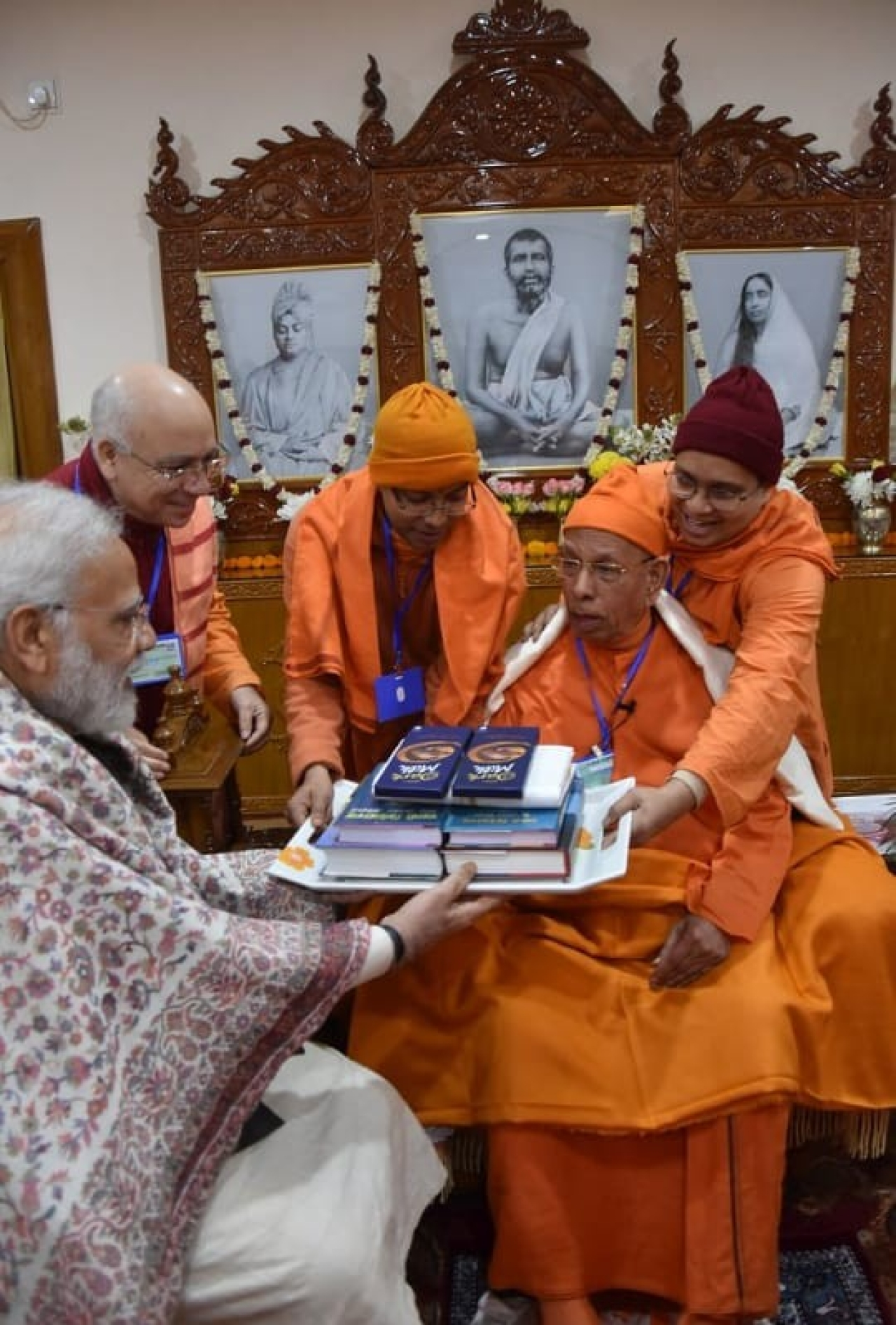 Monks of the order gifting the PM some books.