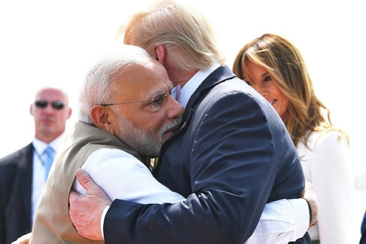 Watch: Trump Hugs PM Modi After Alighting From Air Force One With Wife Melania In Ahmedabad