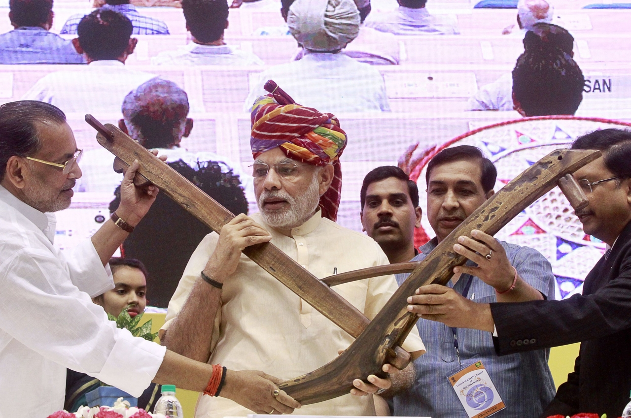Prime Minister Narendra Modi being presented a model of plough by Agriculture Minister Radha Mohan Singh. (Photo by Sanjeev Verma/Hindustan Times via Getty Images)