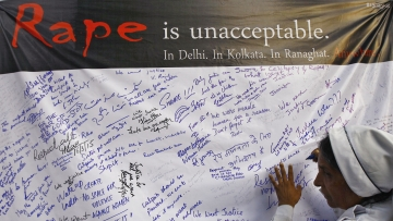 Signatures on an anti-rape banner.