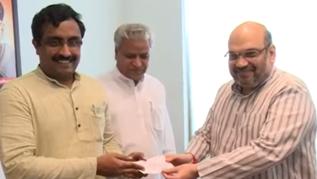 File photo of BJP General Secretary Ram Madhav with BJP President Amit Shah (right). (Photo Courtesy: BJP/YouTube)