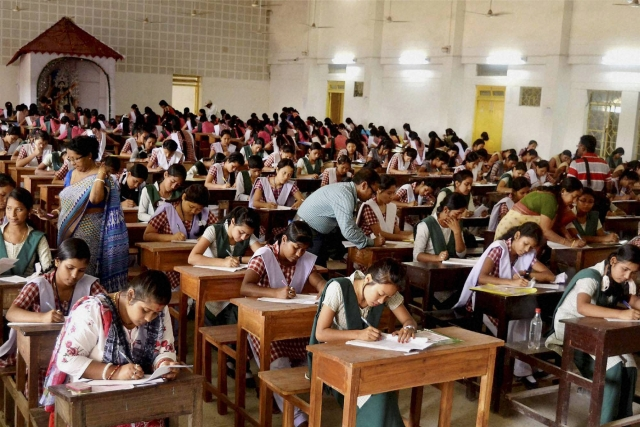Students appear for class 12th Board exams in a school, at Agartala. (Photo: PTI)