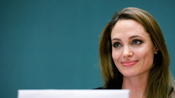 Angelina Jolie says she suffered from Bell's Palsy and hypertension after her separation from Brad Pitt.