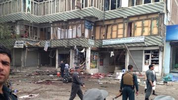File photo: Afghan security forces inspect the site of a suicide attack near a bank branch in Jalalabad, east of Kabul, Afghanistan, Saturday, 18 April 2015.