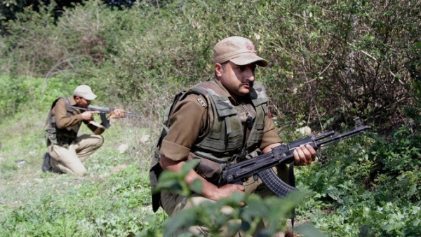 File photo of armed forces taking their positions during an encounter. Image used for representation. (Photo: PTI)