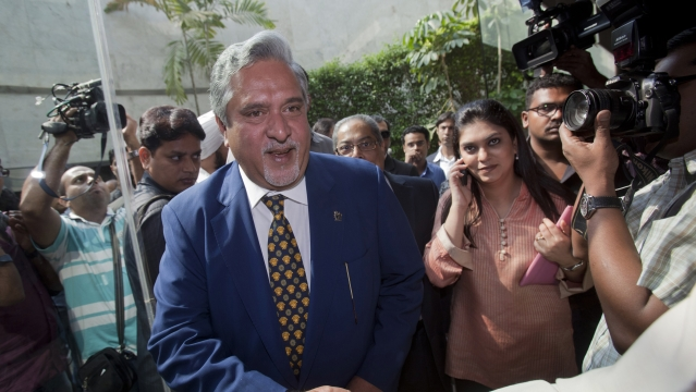 Kingfisher Airlines Chairman Vijay Mallya (C) shakes hands with a well-wisher as he arrives for a news conference in Mumbai November 15, 2011 (Photo: Reuters)