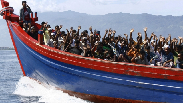 Rohingya refugees from Myanmar being transported by a wooden boat to a temporary shelter in Krueng Raya in Indonesia. (Photo: Reuters)