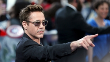 "Robert Downey Jr poses at the European premiere of ""Avengers: Age of Ultron"" Photo: Reuters)"