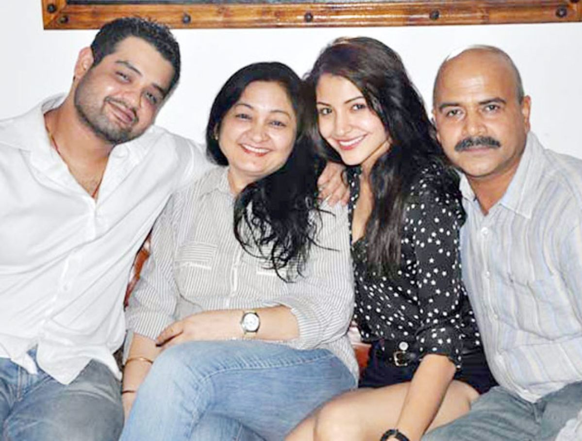 Anushka with her parents and brother