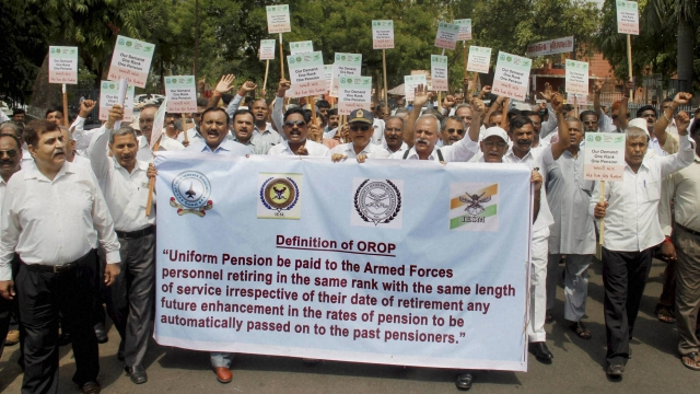 """Ex-servicemen of Gujarat protest to demand """"One Rank One Pension""""  in Ahmedabad on Sunday. (Photo: PTI)"""