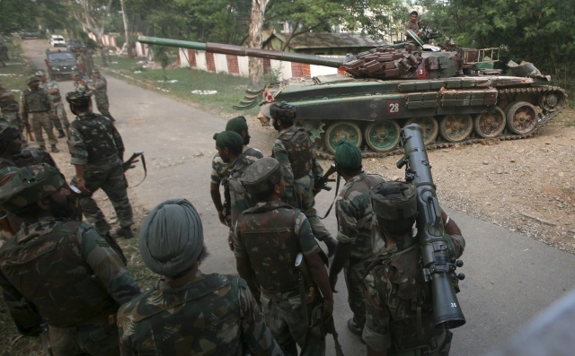 File photo of an Indian army tank, moving past soldiers during a search operation. (Photo: Reuters)