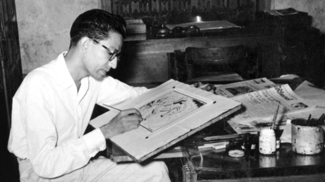 Archival photograph from Raj Thackeray's book on Bal Thackeray showing him sketching a cartoon for the <i>Free Press Journal</i>.