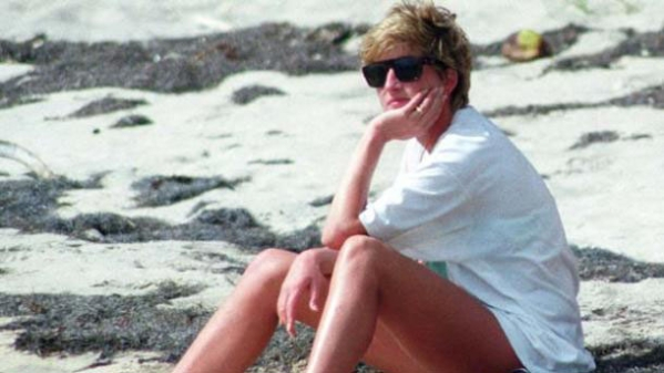 Princess Diana relaxes on the  beach on a trip to the Caribbean Island of Nevis, 4 January  1993.