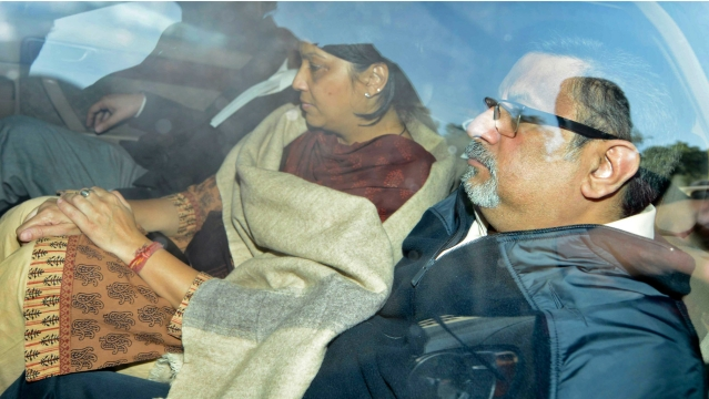 File picture of Aarushi's parents Rajesh Talwar (R) and Nupur being taken to a court in 2013.