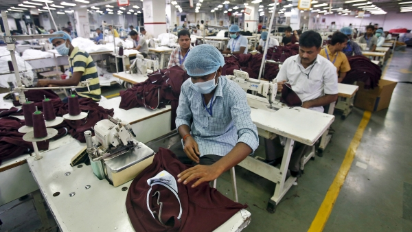 Employees work inside a garment factory of Orient Craft Ltd in Gurgaon in Haryana.