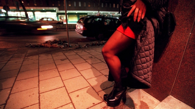 A prostitute waits for business on Malmskillnadsgatan street in central Stockholm despite the bone piercing cold. (Photo: Reuters)