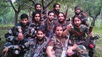 A group photo of Hizbul and Lashkar militants with Burhan Wani  at the centre. (Photo Courtesy: IBN Live)
