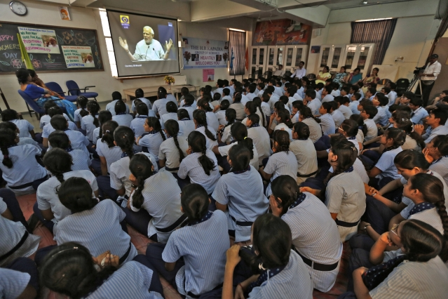 Students watch Indian Prime Minister Narendra Modi on screen as he speaks during a nationwide address to school children during Teachers' Day in the western Indian city of Ahmedabad September 5, 2014. (Photo: Reuters)