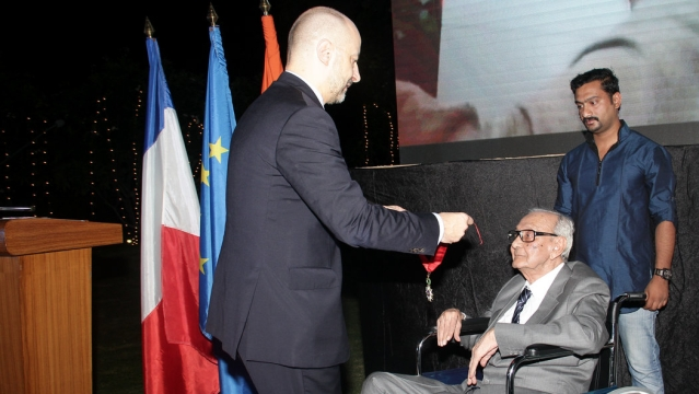 Raza being pinned the medal by French Ambassador Francios Richer, on behalf of the French President. (Photo courtesy: Sahar Zaman)