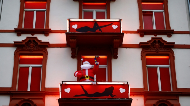 A huge inflatable Father Christmas figure is seen in the balcony of a brothel in the red-light district of Frankfurt. (Photo: Reuters)