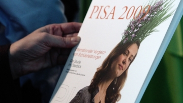 A person holds the 2009 OECD education report, the PISA (Programme for International Student Assessment) study, during a news conference in Vienna, December, 2010. (Photo: Reuters)
