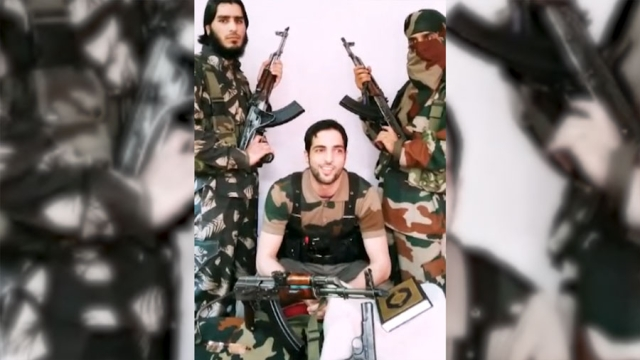 A still of Burhan Wani, 21-yr-old commander of the Hizb-Ul-Mujahideen with Saddam Padder on the left. (Photo Courtesy: ANI Screengrab)